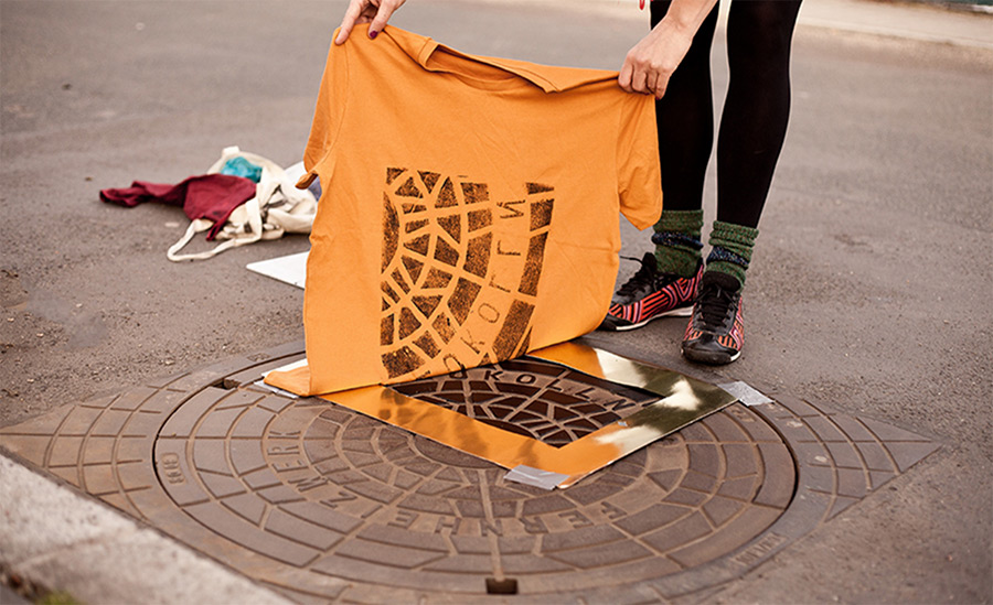 Shirts and totes printed directly on urban utility covers